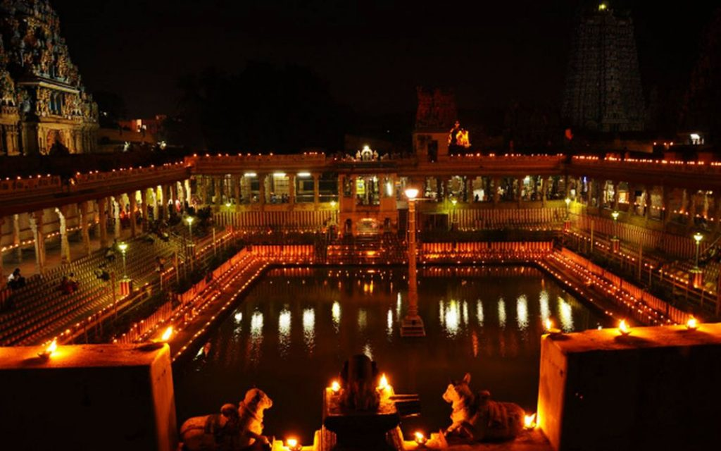 Earthen lamps glowing at the Golden Lotus Tank of Meenakshi SundareswararTemple in the city in view of 'Karthigai Deepam'