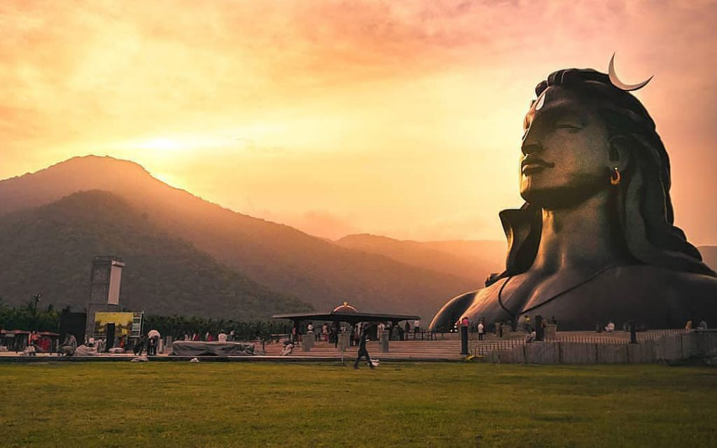 A beautiful view of Adiyogi Siva Statue with the backdrop of Vellayangiri mountain in the evening.