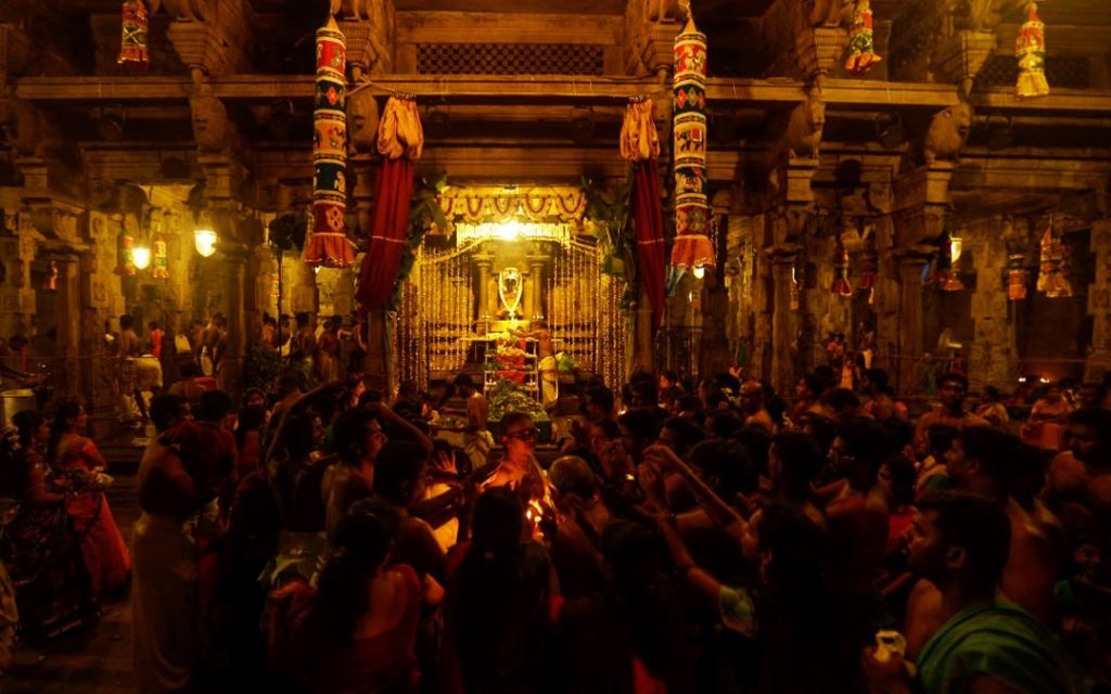 Devotees performing rituals and prayers on the occasion of the Maha Shivratri festival in a Siva temple