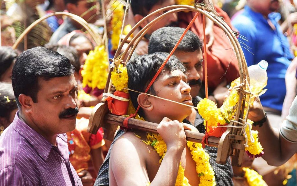 A young devotee participating in the Kavadi procession on the occasion of Thaipoosam