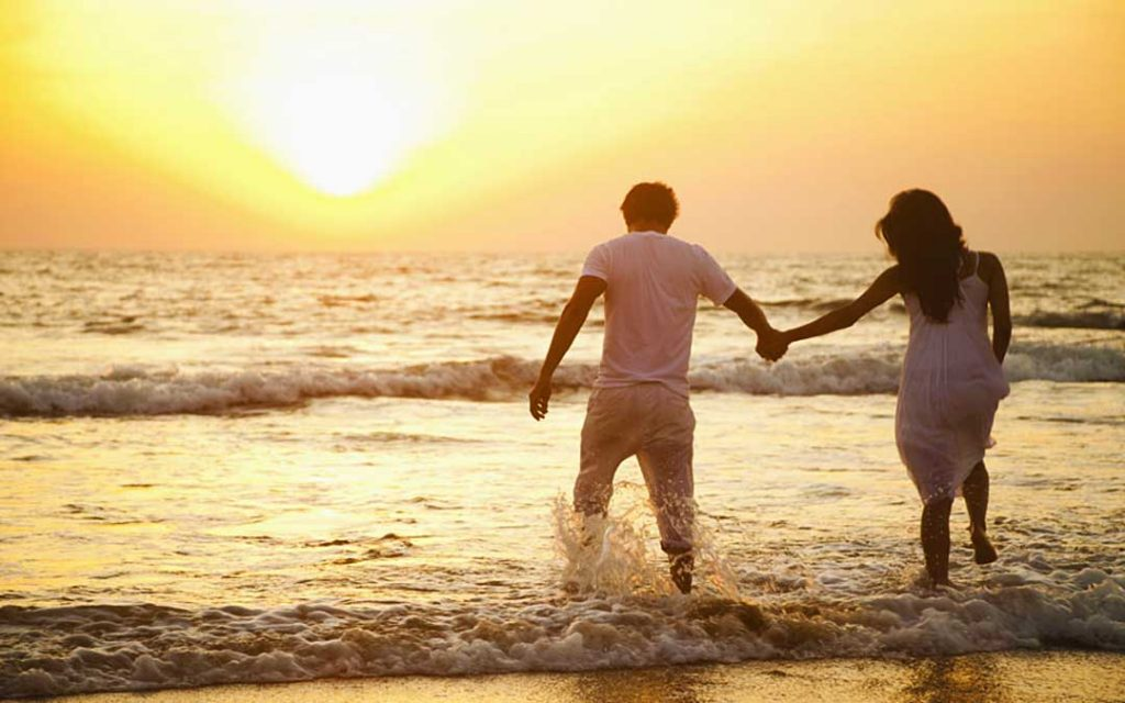 A young and lovely couple enjoying in Pondicherry beach