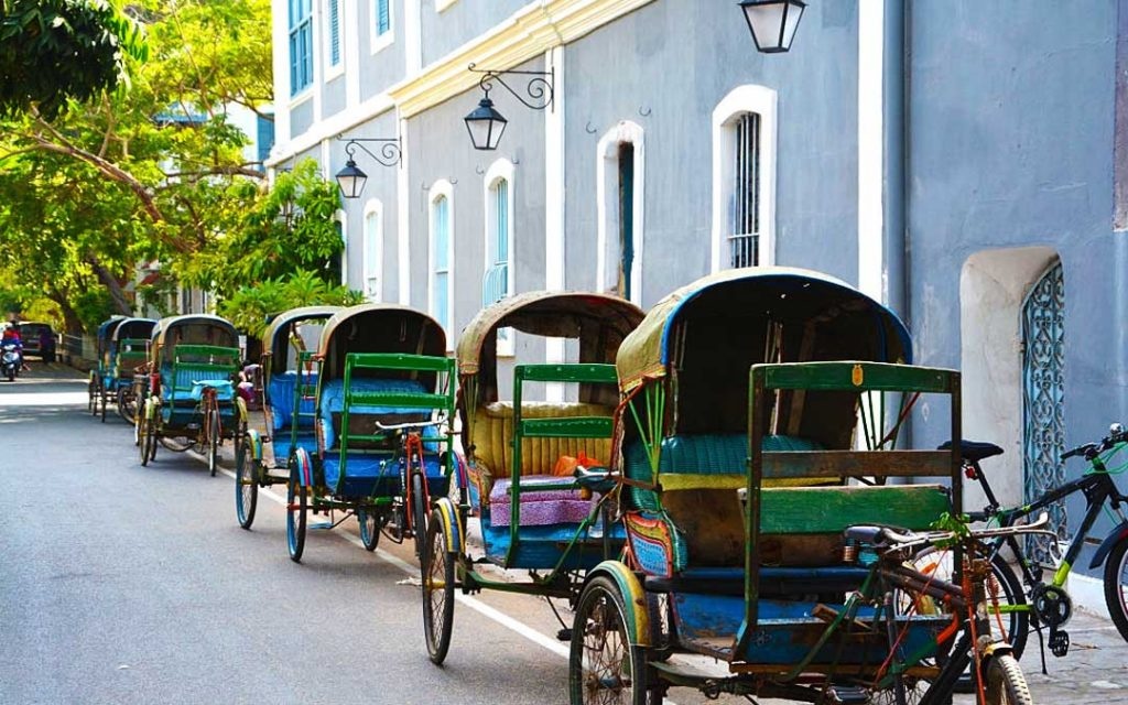 Cycle rickshaws parked in the Law de Lauristor street outside Sri Aurobindo Ashram in the french colony of Pondicherry or Puducherry, India.